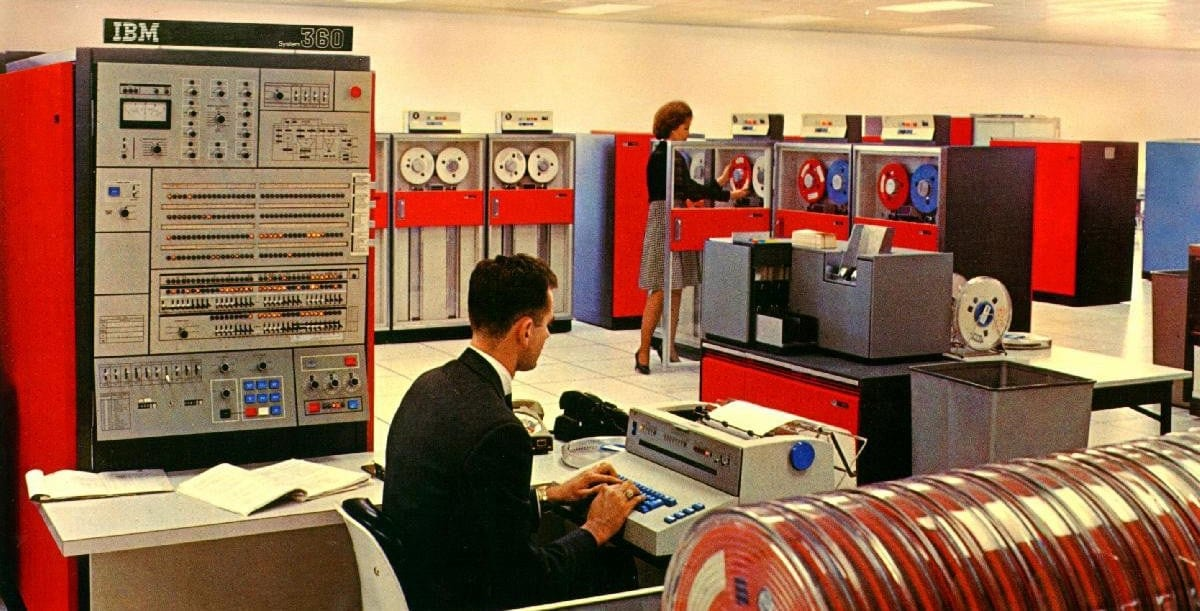 People working on an IBM mainframe computer.